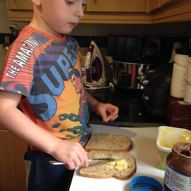Making his own sandwich