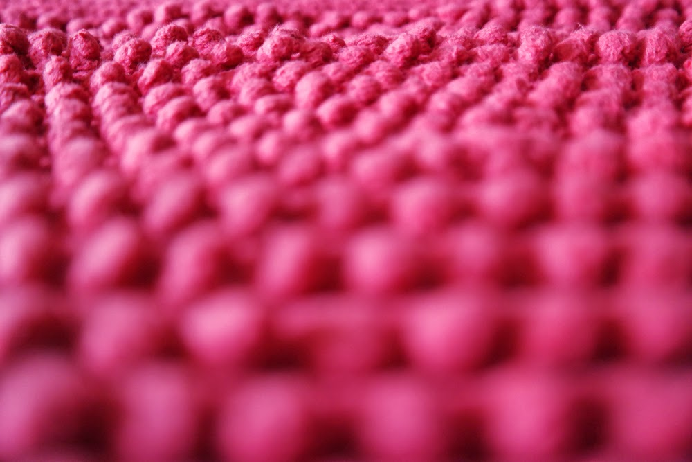 Red bobbly bath mat