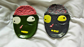 A photography of a pair of ceramic zombie heads Saudi Arabia blog