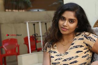 Telugu Actress Karunya Chowdary Stills in Short Dress at ATM Not Working Press Meet  0306.jpg