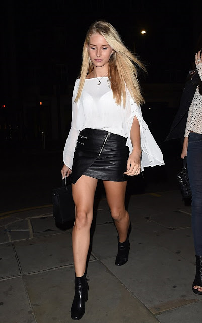 Charlotte Moss in a leather mini-skirt