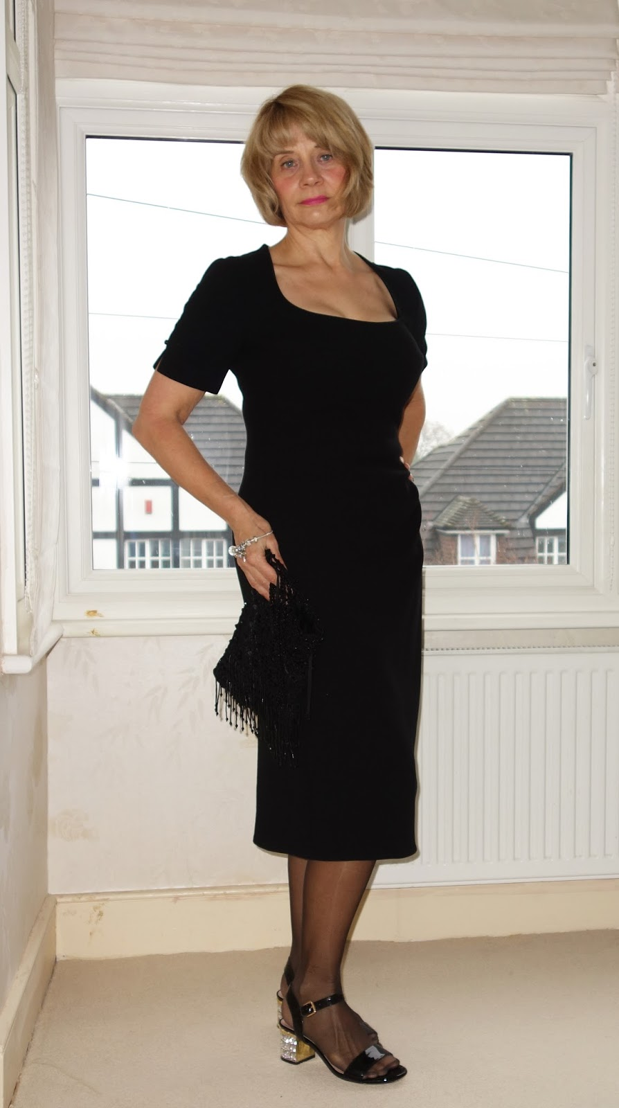 Black crepe figure flattering dress with Dune block heeled shoes