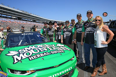Daniel Hemric poses with partners from Smokey Mountain Herbal Snuff before the April 2017 NASCAR Xfinity Series race at Texas Motor Speedway.