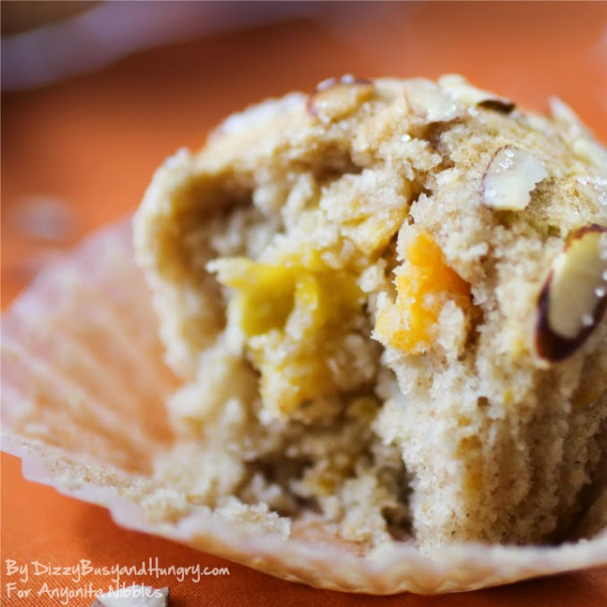Moist muffings filled with mango and topped with sliced almonds on Anyonita Nibbles from Dizzy Busy and Hungry