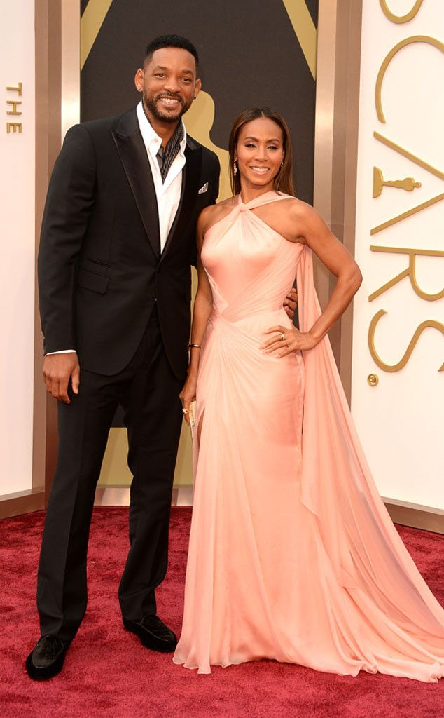 Jada Pinkett Smith in a peach Versace dress with Will Smith at the Oscars 2014