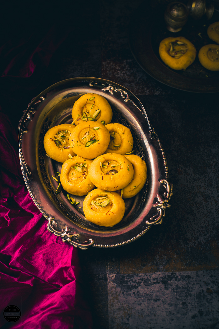 Kesar Malai Peda is a scrumptious which is prepared with paneer, khoya and sugar and flavoured with Saffron. These can be made at home for any festive occasions.
