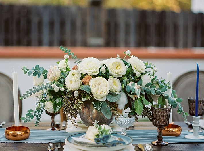 Beautiful wedding centerpiece with white and peach florals and greenery | Photo by Dennis Roy Coronel | See more on thesocalbride.com