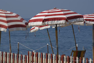 Image: Beach Parasol and sea, province of Imperia, Italy  (c) FreeFoto.com. Photographer: Ian Britton