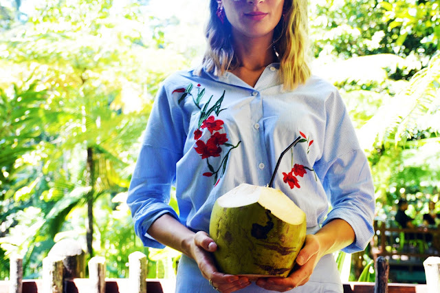 girl holding tropical coconut kuranda