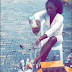 Nigerian lady bathes herself with 100 bottles of champagne to celebrate graduation (video)