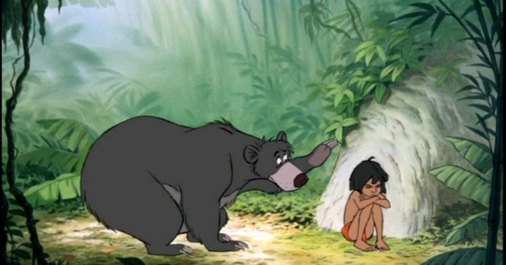 Baloo looking at Mowgli in Disney's The Jungle Book  animatedfilmreviews.filminspector.com