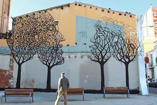 Street Art By Spanish Artist Sam3 On The Streets Of Barcelona in Spain. 1
