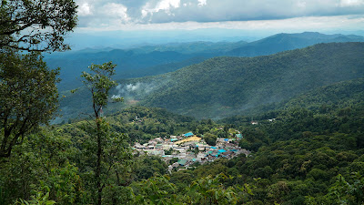Hmong village nestled in a lush jungle