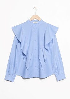 https://www.stories.com/es/Sale/All_sale/Frilled_Blouse/590757-0559456002.2