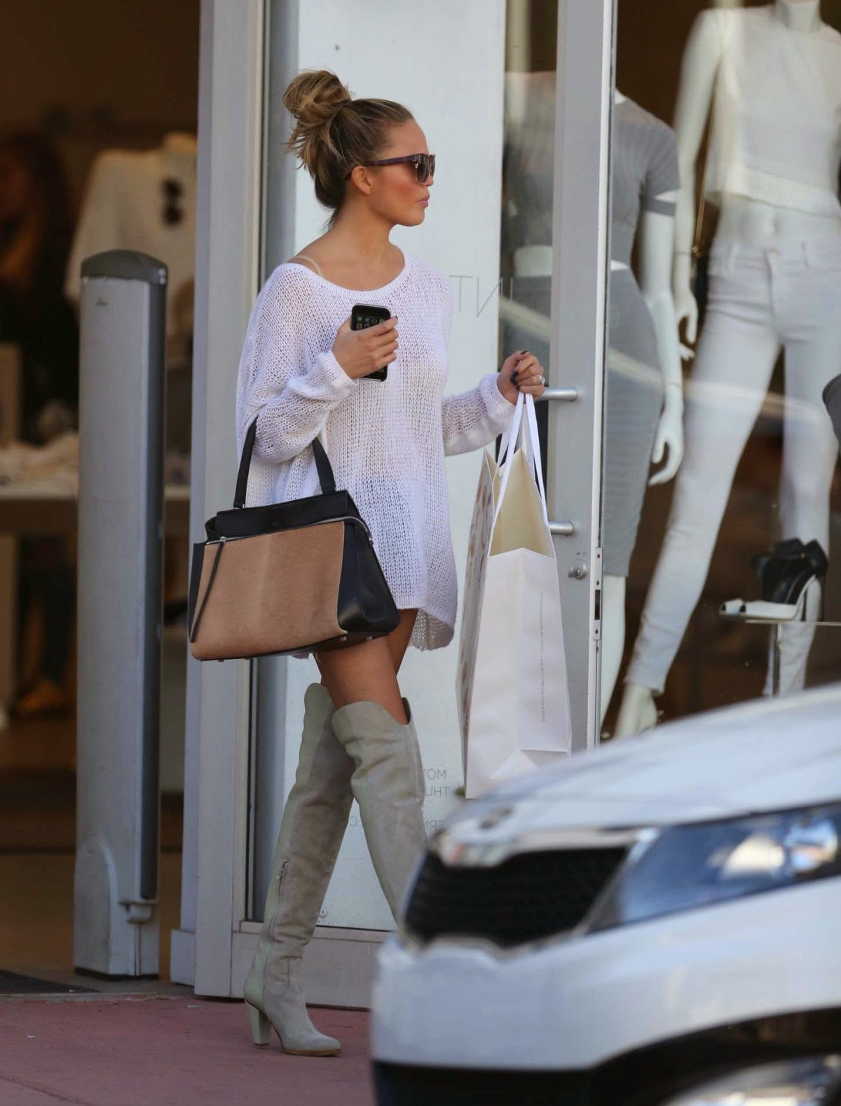 f565c37754012 February 23, 2015 - Chrissy Teigen shopping in Miami Florida wearing Chloé  Suede and Textured-leather Over-the-knee Boots which retail for $1,370