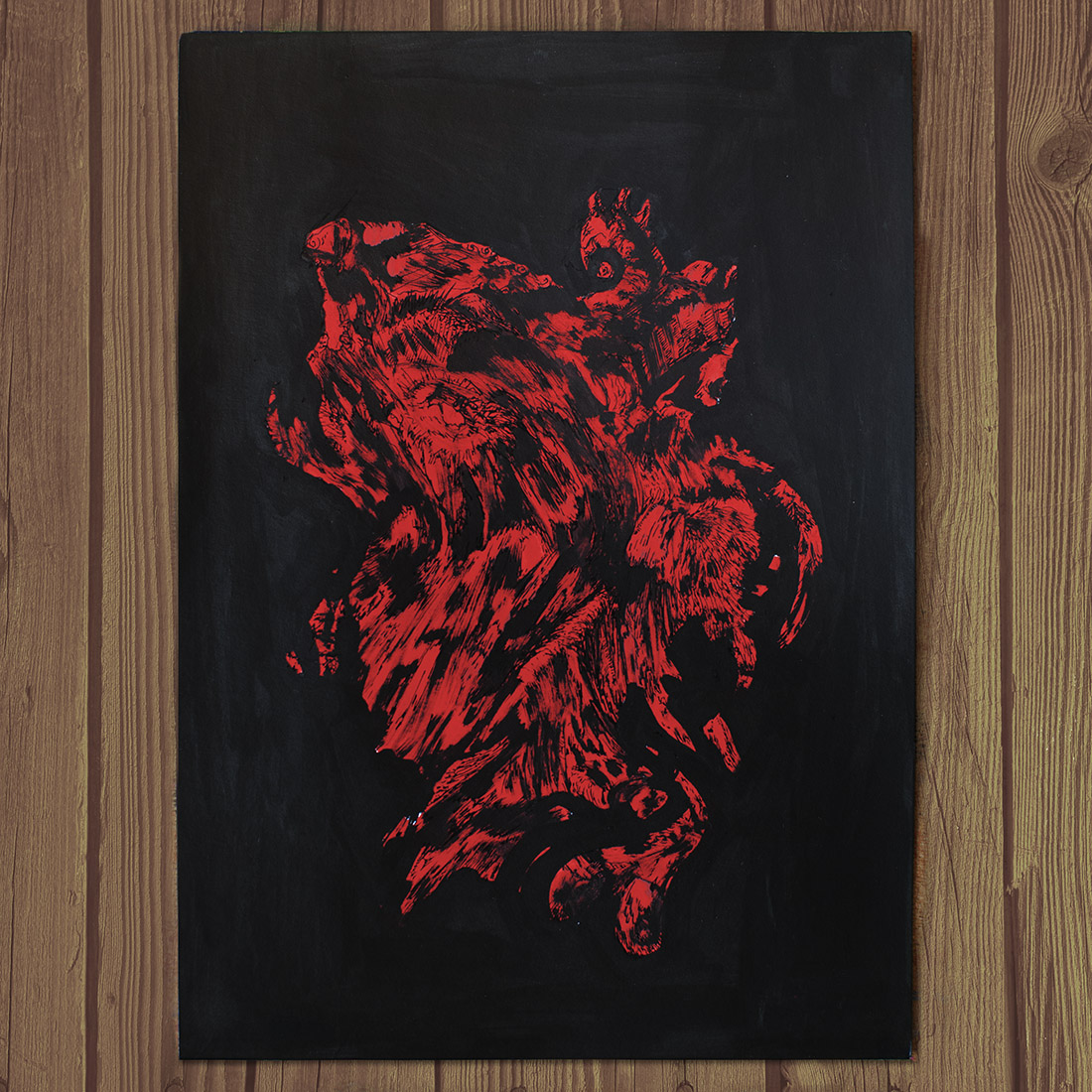 Photo of Kostas Gogas' artwork 'Monstrous Red', a red, high-contrast abstract shape on a black background.