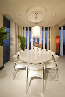 Minimalist Modern Dining Space with White Dining Room Tables And Chairs under the Bright Track Lamp