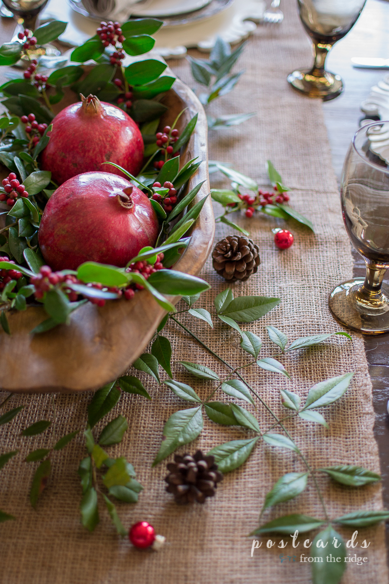 Love this natural Christmas centerpiece with the holly and pomegranates in the wood dough bowl.