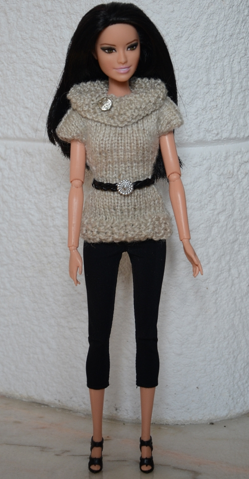 Handmade knitted sweater for Barbie doll.