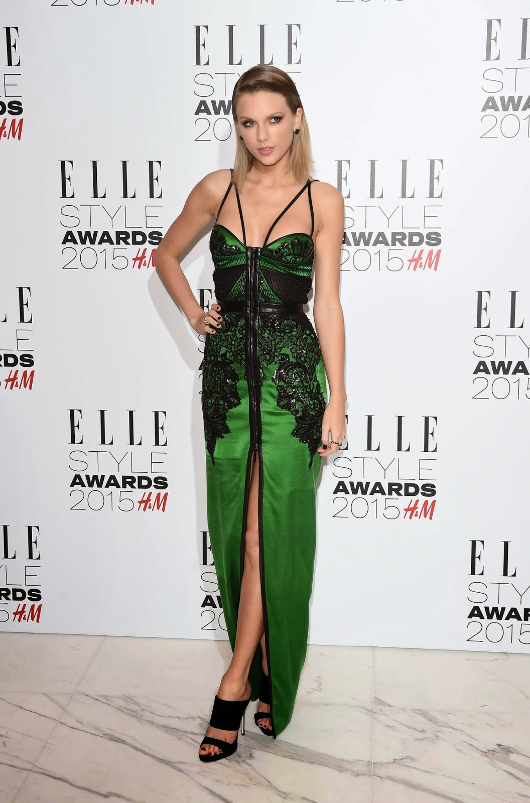 Taylor Swift is sultry in green at the 2015 Elle Style Awards in London