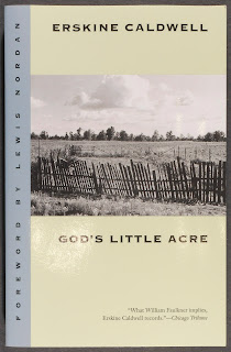 "A cover for ""God's Little Acre,"" showing a black and white photograph of a fenced-in patch of land."