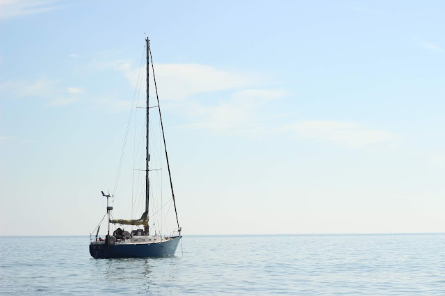 Sailing boat on calm seas