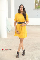 Actress Poojitha Stills in Yellow Short Dress at Darshakudu Movie Teaser Launch .COM 0007.JPG