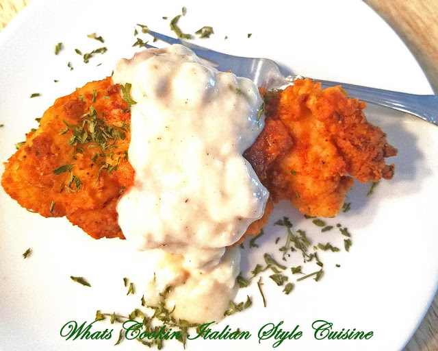 This is chicken fried with a coating and topped with white gravy it has herbs spices and very popular in Southern States
