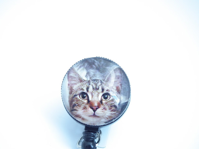 Completed badge reel with photo of kitty