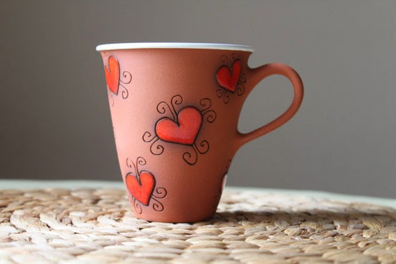 https://www.etsy.com/listing/95555343/tall-tea-cup-with-love-motif-clay?ref=shop_home_feat_1