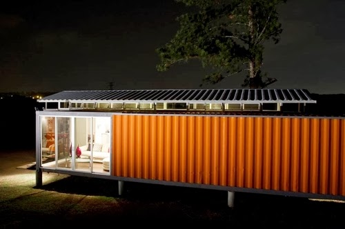 04-Night-Side-View-Recycled-Container-House-Architect-Benjamin-Garcia-San-Jose-Costa-Rica-Solar-Panels-Recycled-Metal-www-designstack-co
