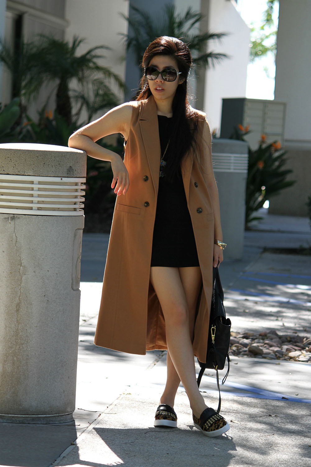 Adrienne Nguyen_Invictus_Calf Hair Slip-On's Kate Spade_Duster Coat and Black Dress