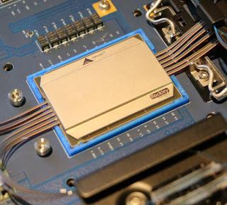 Integració de components òptics en dissenys de xips existents