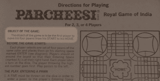 A photo of the rules for Parcheesi printed on the inside of the box top. The object of the game is highlighted: it reads 'The object of the game is to be the first player to move his four pawns from his START to his HOME.'