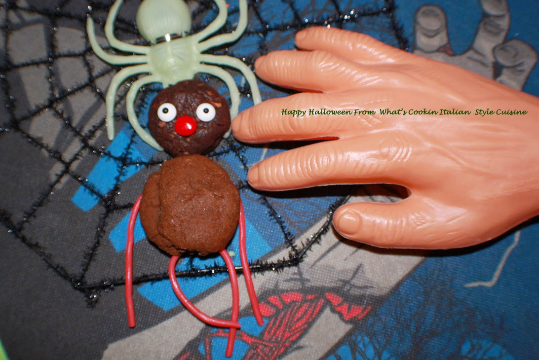 These are a chocolate cookies made into a cookie monster for Halloween and on a Halloween spider plate with a fake hand