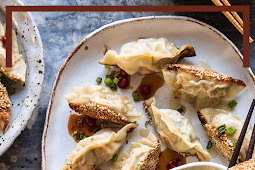 Ginger Sesame Chicken Potstickers with Sweet Chili Pomegranate Sauce