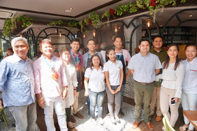 Rico Dionson with Family and Friends at the blessing of Rico's Lechon Axis