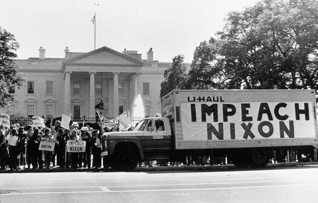 Protest, Impeach Nixon sign on a moving  van in front of the White House. Misspelled Impeach. marchmatron.com.