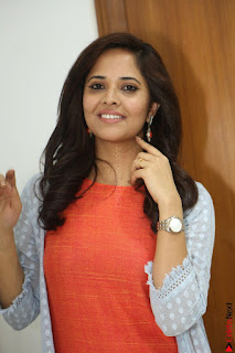 Actress Anasuya Bharadwaj in Orange Short Dress Glam Pics at Winner Movie Press Meet February 2017 (62).JPG