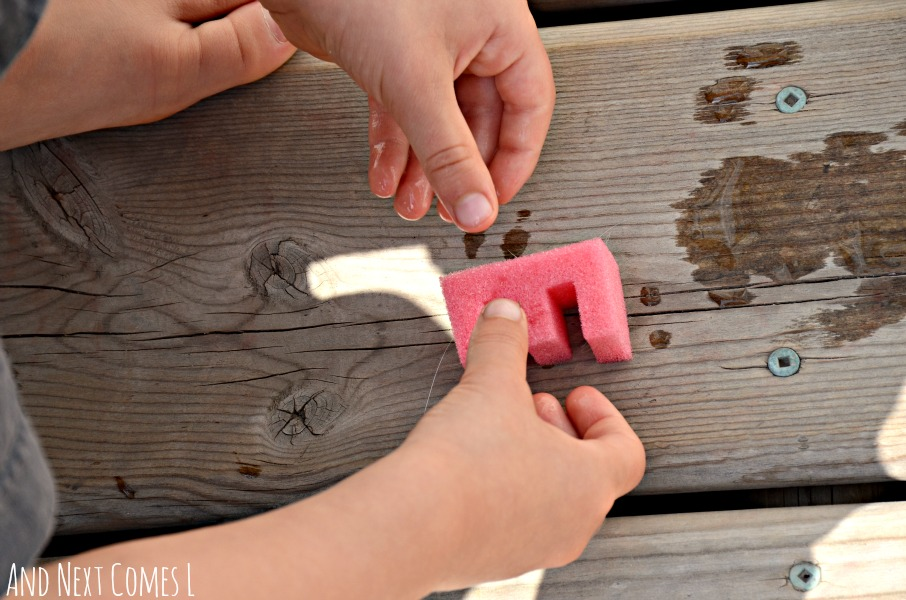 Stamping with alphabet sponges {water sensory play} from And Next Comes L