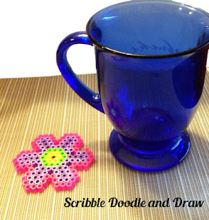 Have kids make a flower out of perler beads for mother's day gift