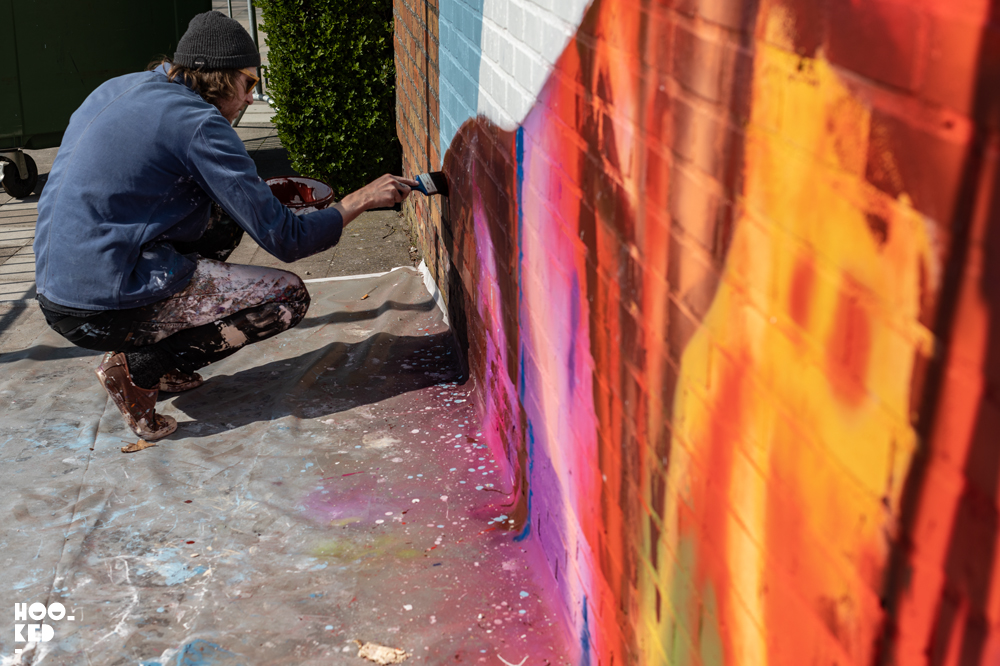 Artist David Walker painting his mural In Ostend, Belgium