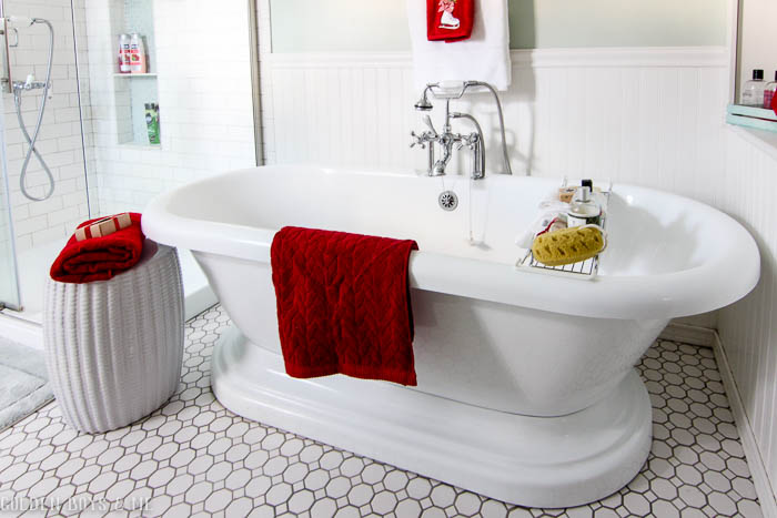 Pedestal tub in master bathroom with holiday decor