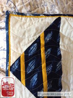 Shibori quilt showing flange binding