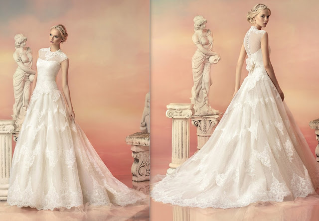 http://www.landybridal.co/perfect-illusion-dropped-train-tulle-ivory-sleeveless-wedding-dress-with-flower-and-appliques-lwxt150a5.html