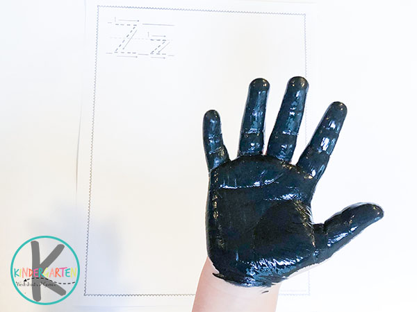 paint hand with black washable paint