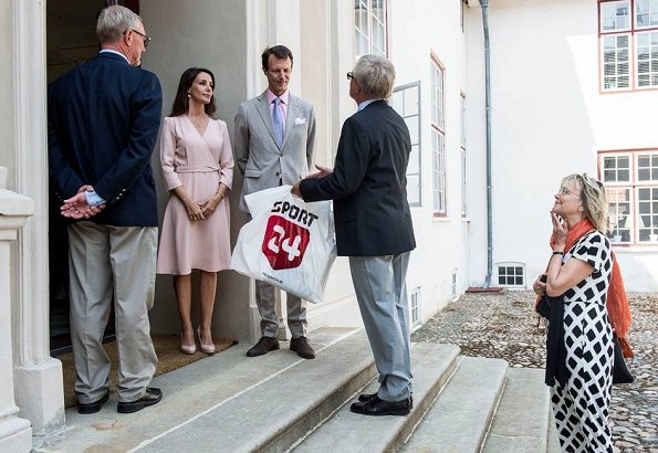 Princess Marie wore GOAT Fashion ballerina wrap dress. Prince Joachim and Princess Marie held a reception for representatives of the charities