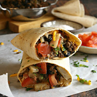 Tortillas filled with spiced ground beef, potatoes, beans and cheese.