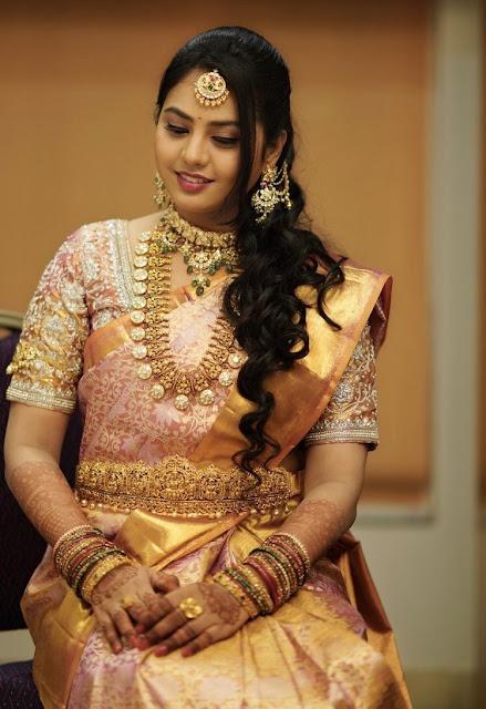 Bride in Lakshmi Bottu Mala