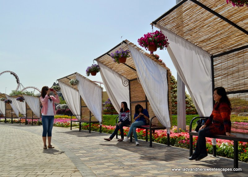 shaded benches at Dubai Miracle Garden